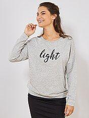 Dunne sweater met opschrift in kraaltjes