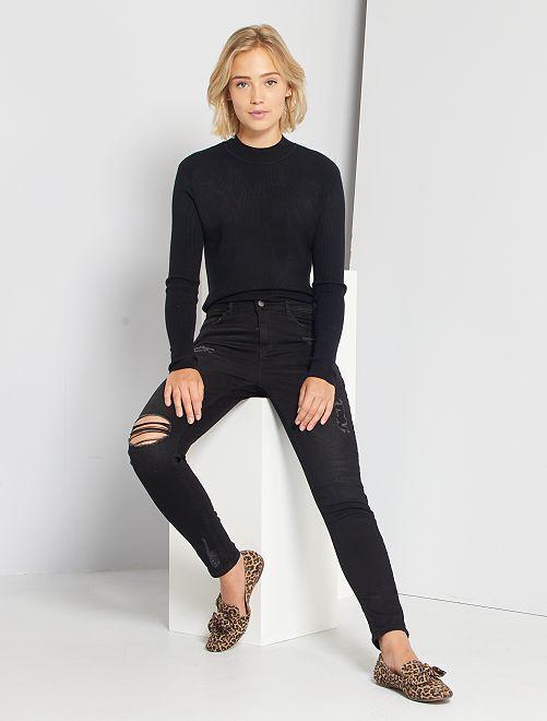 Skinny jeans met versleten plekken en een zeer hoge taille                                                     ZWART Dameskleding