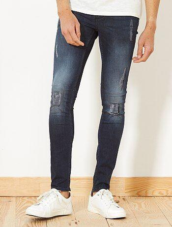 Stretch skinny jeans met versleten plekken - Kiabi